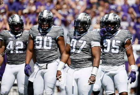 Ty Summers, Terrell Lathan, Chris Bradley, Aaron Curry Linebacker Ty Summers (42), defensive end Terrell Lathan (90), defensive tackle Chris Bradley (97) and defensive tackle Aaron Curry (95) approach the line of scrimmage during the first half of an NCAA college football game against Stephen F. Austin in Fort Worth, Texas