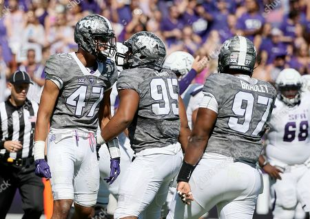 Tipa Galeai, Chris Bradley, Zach Conque Defensive end Tipa Galeai (47), defensive tackle Aaron Curry (95) and defensive tackle Chris Bradley (97) celebrate a sack of Stephen F. Austin quarterback Zach Conque (2) during an NCAA college football game in Fort Worth, Texas