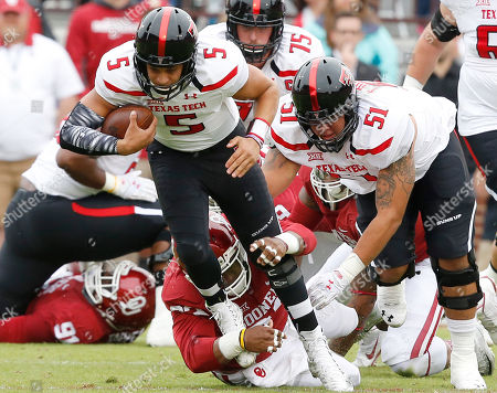 Patrick Mahomes, Jordan Wade Texas Tech quarterback Patrick Mahomes (5) is pulled down by Oklahoma defensive tackle Jordan Wade, bottom, in the first quarter of an NCAA college football game in Norman, Okla