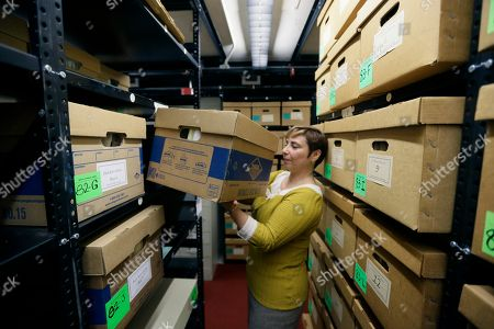 In a photo from, in Ann Arbor, Mich., Olga Virakhovskaya Lead Archivist for Collections Management, Bentley Historial Museum, University of Michigan moves a box containing files on assisted suicide that belonged to Dr. Jack Kevorkian.The archive, donated by Ava Janus, Kevorkian's niece and sole heir, is stored in one of nine boxes in the stacks of the Bentley Historical Library in Ann Arbor