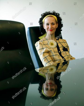 Stock Photo of In a photo from, in Birmingham, Mich., Ava Janus, Dr. Jack Kevorkian's niece and sole heir, is interviewed in Kevorkian's attorney's office. Janus donated her uncle's files on assisted suicide to the Bentley Historical Library at the University of Michigan