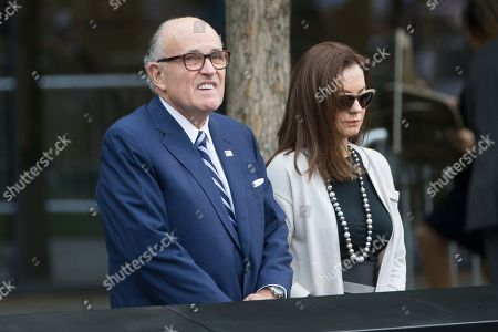 Rudy Giuliani, Judith Giuliani Former New York City Mayor Rudy Giuliani, left, and his wife Judith Giuliani, visit the south pool of the 9/11 Memorial in downtown Manhattan before the arrival of Pope Francis, in New York