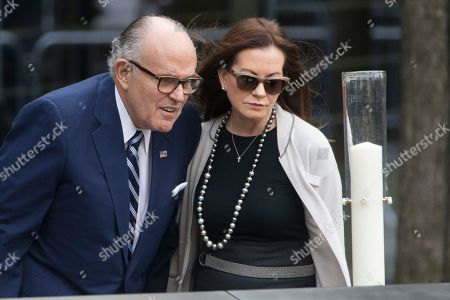 Rudy Giuliani, Judith Giuliani Former New York City Mayor Rudy Giuliani, left, and his wife Judith Giuliani, inspect a candle intended for Pope Francis to light during his visit the south pool of the 9/11 Memorial in downtown Manhattan, in New York