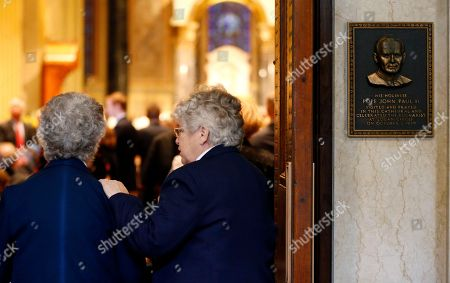 A plaque honoring Pope John Paul II's visit to Cathedral Basilica of Sts. Peter and Paul is on display near the entrance of the temple before a Mass given by Pope Francis, in Philadelphia