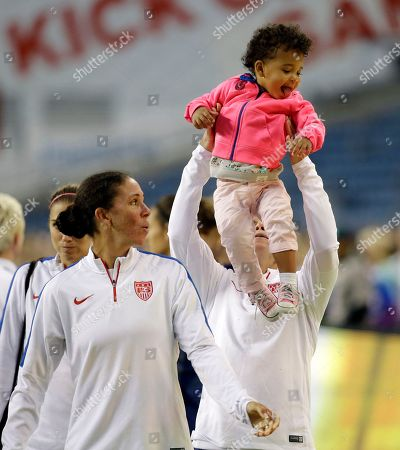 "Christie Rampone, Shannon Boxx United States women's national soccer team's Shannon Boxx, left, watches as Christie Rampone lifts Boxx's daughter Zoe Spearman, 20 months, after a soccer practice, in Seattle. The team plays a friendly match against Brazil on Wednesday, as part of their ""victory tour"" following their World Cup championship earlier this year"