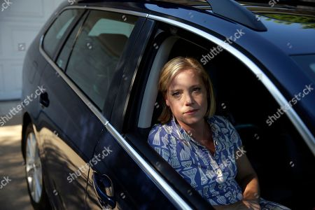 HOLD FOR STORY SLUGGED: Volkswagen Owners -- Zandy Hartig poses for a picture in her 2013 Volkswagen Jetta Sportwagen diesel, in Studio City, Calif