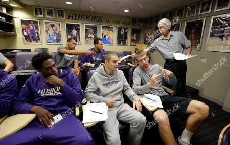 Noah Dickerson, Dan Kingma, Greg Bowman, Devenir Duruisseau, KJ Garrett Professor Shawn Wong hands out papers to Washington men's basketball players during a class in Chinese culture in Seattle. In the front row are Noah Dickerson, left, Dan Kingma and Greg Bowman, and seated behind are Devenir Duruisseau and KJ Garrett. Washington is embarking on a unique journey to begin the 2015-16 basketball season. The team will fly to China to open the season against Texas in Shanghai, the first regular season college basketball game ever played in China