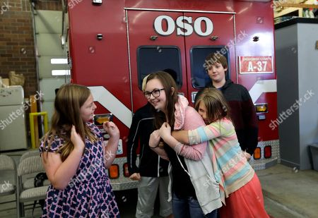 Seventh grader Amanda Brown is surrounded by classmates congratulating her after finishing a rap song about what to do in an earthquake following an earthquake drill as part of a statewide Great Shakeout drill at the Oso firehouse, in Oso, Wash. Secretary of the Interior Sally Jewell was in the area to view for the first time the devastation caused by last year's landslide off Highway 530 and to participate in the drill with school children from nearby Darrington, Wash