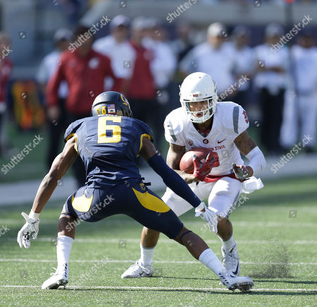Washington State's Gabe Marks, right, is stripped of the ball by California's Darius White during the second half of an NCAA college football game, in Berkeley, Calif. California won the game 34-28