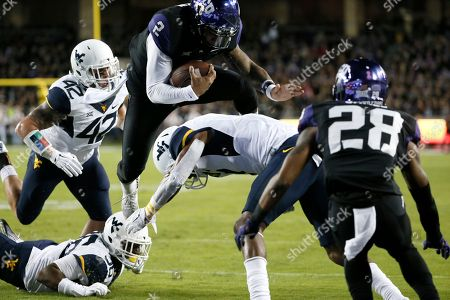Tony James, Trevone Boykin, Daryl Worley, Jared Barber, Shq Petteway TCU quarterback Trevone Boykin (2) leaps over West Virginia cornerback Daryl Worley into the end zone for a touchdown after getting by West Virginia's Jared Barber (42) and Shaq Petteway, bottom, in the first half of an NCAA college football game, in Fort Worth, Texas. TCU's Tony James watches on the play