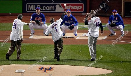 New York Mets hall of famers from left, Cleon Jones, Mookie Wilson and Darryl Strawberry throw out ceremonial first pitches before Game 5 of the Major League Baseball World Series against the Kansas City Royals, in New York