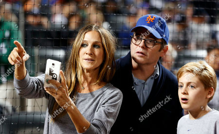 Stock Picture of Sarah Jessica Parker, Matthew Broderic,James Broderick Actress Sarah Jessica Parker points to the New York Mets dugout with husband Broadway actor Matthew Broderick, center, and their son James, as they stand on the field before a baseball game between the Mets and the New York Yankees in New York