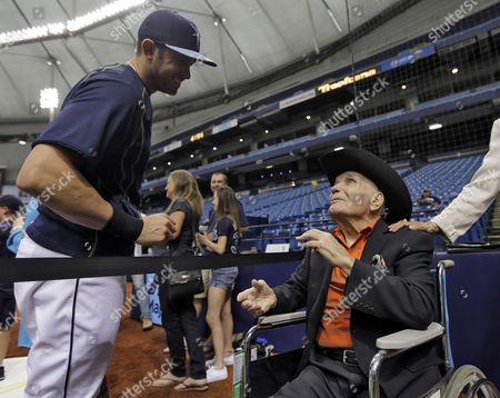 Stock Image of Jake LaMotta, Evan Longoria Former middleweight boxing champion Jake LaMotta, seated right, meets with Tampa Bay Rays third baseman Evan Longoria as he watches batting practice before a baseball game between the Rays and the New York Yankees, in St. Petersburg, Fla