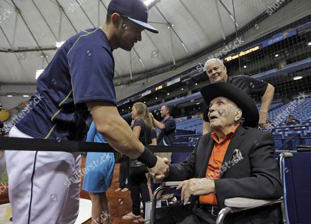 Stock Photo of Jake LaMotta, Evan Longoria Former middleweight boxing champion Jake LaMotta, right, shakes hands with Tampa Bay Rays third baseman Evan Longoria during batting practice before a baseball game between the Rays and the New York Yankees, in St. Petersburg, Fla