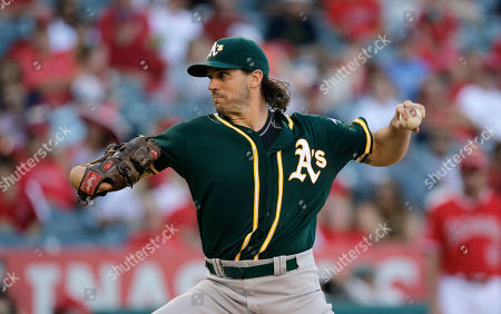"Barry Zito Oakland Athletics starting pitcher Barry Zito throws against the Los Angeles Angels during the second inning of a baseball game in Anaheim, Calif. Zito made the announcement that he is retiring as planned in an article he wrote for ""The Players' Tribune"" posted Monday, Oct. 19, saying, ""I'm retiring today from baseball, but I'll never be too far away from the game that made me who I am"