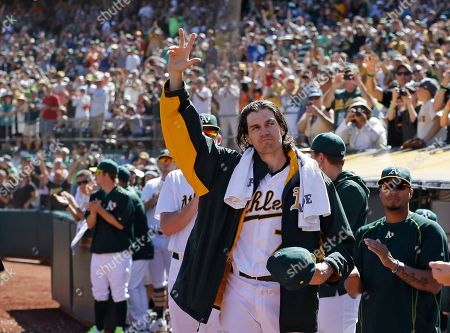 "Barry Zito Oakland Athletics pitcher Barry Zito waves to fans as he leaves the baseball game against the San Francisco Giants in the third inning of a baseball game in Oakland, Calif. Zito made the announcement that he is retiring as planned in an article he wrote for ""The Players' Tribune"" posted Monday, Oct. 19, saying, ""I'm retiring today from baseball, but I'll never be too far away from the game that made me who I am"