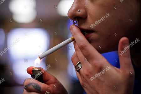 Altria; Marlboro; smoking; cigarettes Store manager Stephanie Hunt lights a Marlboro cigarette while posing for photos at a Smoker Friendly shop in Pittsburgh