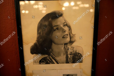 Stock Photo of A photo of Katharine Hepburn shows some water damage from Hurricane Katrina inside Antoine's Restaurant in New Orleans, . The restaurant last year reached its pre-Katrina sales of about $10 million. Next week it will hold a series of events to celebrate its 175th anniversary. The highlights include a visiting chef from Delmonico's in New York who will team up with Antoine's Chef Mike Regua to offer special menus, a block party with a brass band and a Prohibition-themed gala