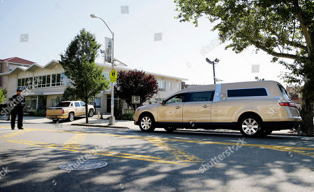 A gold colored hearse carrying the coffin bearing the body of Bobby Kristina Brown arrives at Whigham Funeral home in Newark, N.J., early . Bobbi Kristina, the only child of Whitney Houston and R&B singer Bobby Brown, died in hospice care July 26, about six months after she was found face-down and unresponsive in a bathtub in her suburban Atlanta townhome