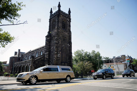 A gold colored hearse carrying the coffin bearing the body of Bobby Kristina Brown drives past Saint James Church near Whigham Funeral home in Newark, N.J., early . Bobbi Kristina, the only child of Whitney Houston and R&B singer Bobby Brown, died in hospice care July 26, about six months after she was found face-down and unresponsive in a bathtub in her suburban Atlanta townhome