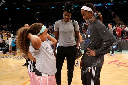 Kymora Johnson, Tina Charles, Swin Cash Kymora Johnson, left, of the Charlottesville Cavaliers, talks to New York Liberty center Tina Charles, center, and forward Swin Cash after an exhibition basketball game against Mount Vernon Recreation, at Madison Square Garden in New York. The 10-year-old girl was thrown into the spotlight earlier this month when her youth team from Virginia was disqualified from a basketball tournament because she played in it. Johnson's the lone girl on the boys' team, the Charlottesville Cavaliers