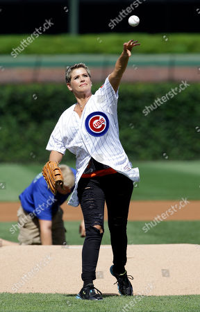 Stock Photo of Kristy Swanson Actress Kristy Swanson throws out a ceremonial first pitch before a baseball game between the Atlanta Braves and the Chicago Cubs, in Chicago