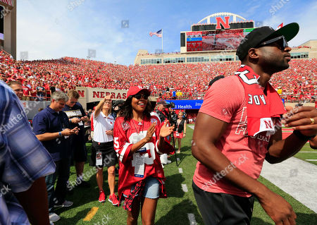 Gabrielle Union, Dwayne Wade Actress Gabrielle Union and her husband Dwayne Wade of the Miami Heat wear Nebraska clothing as they walk the sidelines before an NCAA college football game between Nebraska and Brigham Young in Lincoln, Neb