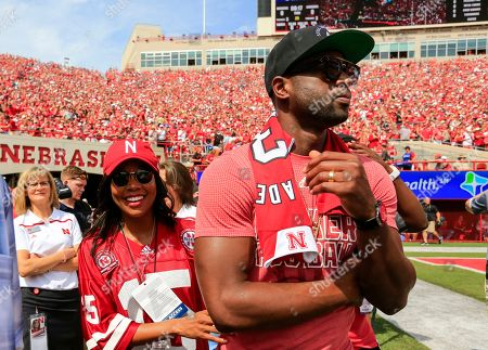 Dwayne Wade, Gabrielle Union Actress Gabrielle Union and her husband, Miami Heat's Dwayne Wade, walk the sidelines before the first half of an NCAA college football game between BYU and Nebraska in Lincoln, Neb
