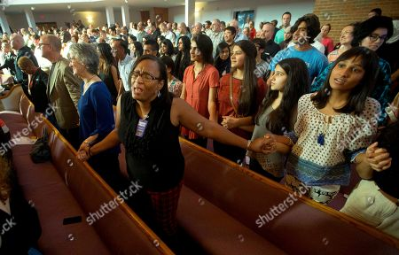 Stock Picture of Connie Fleming Yusra Siddiqui Connie Fleming, left, holds hands with Yusra Siddiqui, during an interfaith memorial service, in Chattanooga, Tenn., for the victims of the Tennessee shootings