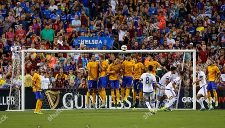 Oscar dos Santos Emboaba Junior Barcelona lines up to block a direct free kick by Chelsea's Oscar dos Santos Emboaba Junior (8) during the first half of an International Champions Cup soccer match in Washington, . Chelsea won 3-2 on penalty kicks