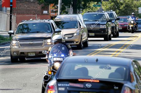Gold colored hearse carrying the coffin bearing the body of Bobbi Kristina Brown arrives with police escort at Whigham Funeral home in Newark, N.J., early . Bobbi Kristina, the only child of Whitney Houston and R&B singer Bobby Brown, died in hospice care July 26, about six months after she was found face-down and unresponsive in a bathtub in her suburban Atlanta townhome