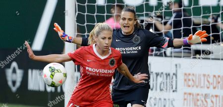 Nadine Angerer, McCall Zerboni Portland Thorns goalkeeper Nadine Angerer, right, yells to Thorns player Portland Thorns midfielder McCall Zerboni as the ball comes towards the goal during the first half of an NWSL soccer match against the Washington Spirit in Portland, Ore., . The teams tied 3-3