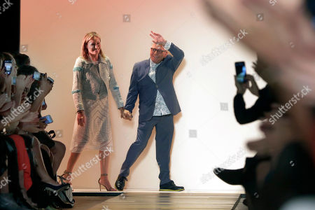 Max Azria, Lubov Azria Designer Max Azria and his wife Lubov acknowledge audience applause after his BCBG MAX AZRIA Spring 2016 collection was modeled, during Fashion Week in New York