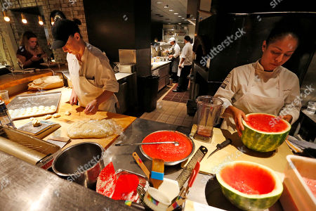 """Stock Image of Chefs prepare food inside Rioja, one of the successful restaurants owned by local businesswoman Jen Jasinski, in downtown Denver, Colo. Jasinski says she's not worried about the Fed's rate hike tamping down Denver's red-hot economy. """"Things are being built, people are moving here, you can see cranes all around,"""" she said"""