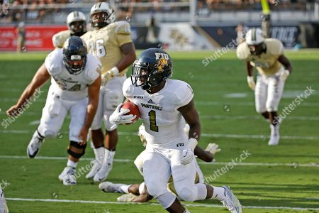 Alex Gardner Florida International running back Alex Gardner (1) carries against the Central Florida defense for a short gain during the first half of an NCAA college football game, in Orlando, Fla