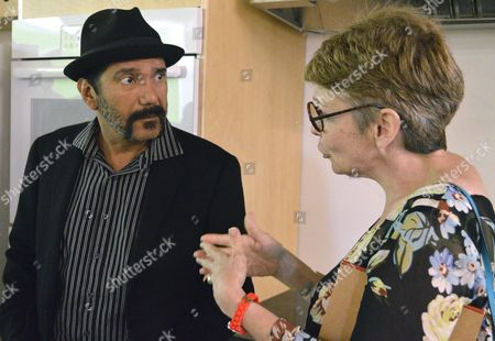 Cynthia Kennedy, right, of Santa Fe, New Mexico, talks to Albuquerque school board member Steven Michael Quezada at the George I. Sanchez Collaborative Community School during a dedication for the new school on . Kennedy is the granddaughter of Sanchez, a noted Mexican-American scholar and civil rights leader who had been virtually unknown in his hometown of Albuquerque until recently