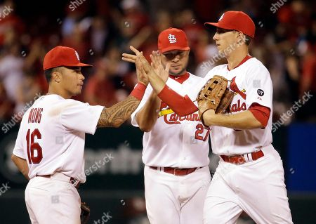 Kolten Wong, Jhonny Peralta, Stephen Piscotty St. Louis Cardinals, from left to right, Kolten Wong, Jhonny Peralta and Stephen Piscotty celebrate following the Cardinals' 2-1 victory over the San Francisco Giants in a baseball game, in St. Louis