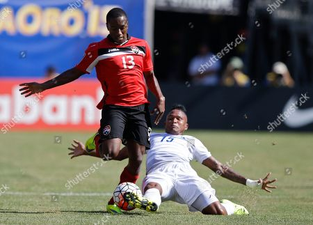 Cordell Cato, Erick Davis Panama's Erick Davis (15) and Trinidad & Tobago's Cordell Cato (13) fight for control of the ball during the first half of a CONCACAF Gold Cup soccer match, at MetLife stadium in East Rutherford, N.J