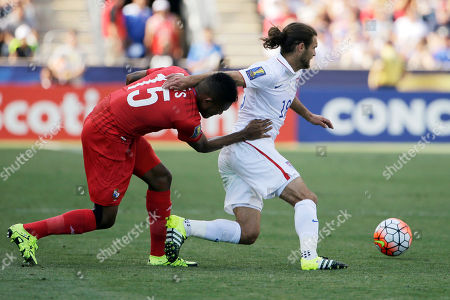 Graham Zusi, Erick Davis United States' Graham Zusi, right, tries to slip past Panama's Erick Davis during the first half of the CONCACAF Gold Cup third place soccer match, in Chester, Pa