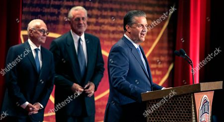 John Calipari, Larry Brown, Pat Riley Basketball Hall of Fame inductee coach John Calipari stands with his presenters Larry Brown, left, and Pat Riley during the enshrinement ceremony for the Class of 2015 of the Naismith Memorial Basketball Hall of Fame in Springfield, Mass