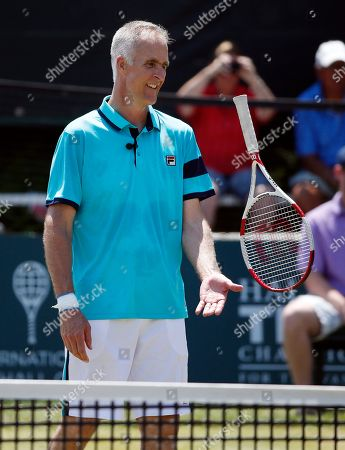 Stock Picture of Todd Martin International Tennis Hall of Fame CEO Todd Martin tosses his racket during an exhibition doubles match at the hall of fame in Newport, R.I