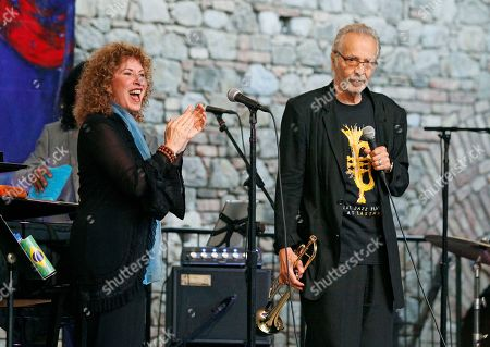 Herb Alpert, Lani Hall Trumpeter Herb Alpert is applauded by his wife, Lani Hall, after playing in the courtyard of the Castello di Amorosa winery in Calistoga, Calif. The performance was part of the Napa Valley Festival del Sole, a 10-day summer festival of music, theater and dance with the region's wine and cuisine. Alpert, 80, is a nine-time Grammy award winner and National Medal of Arts recipient