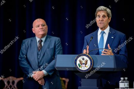 """Stock Image of John Kerry, Tony Maddox Secretary of State John Kerry, right, introduces Tony Maddox of the United States as a """"2015 Trafficking in Persons Report hero"""" whose efforts have made an impact on the global fight against modern slavery, during a news conference where Kerry releases the 2015 Trafficking in Persons Report at the State Department, in Washington. The report assesses the efforts of 188 countries and territories, including the United States to combat modern slavery"""