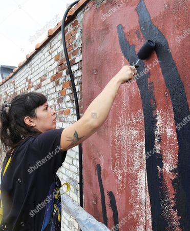 """Stock Picture of Marina Zumi Argentine artist Marina Zumi paints a large gazelle mural on the side of a New York building. Maziar Bahari, the journalist who spent 118 days in an Iranian jail after an appearance on """"The Daily Show with Jon Stewart,"""" and later immortalized in Stewart's film """"Rosewater"""" is using his newfound fame to create campaign called """"Not a Crime,"""" which focuses on journalism and access to education for Iran's largest religious minority, the Baha'i. Part of the outreach effort involves murals painted across New York City"""