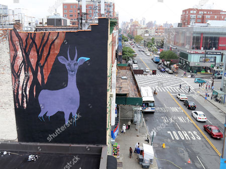 """Marina Zumi A large gazelle mural is shown on the side of a building in the Harlem neighborhood of New York. The mural is one of about half a dozen that have been commissioned as part of a campaign to raise awareness for a nonprofit created by Maziar Bahari, the journalist who spent 118 days in an Iranian jail after an appearance on """"The Daily Show with Jon Stewart. The murals are being painted on buildings around the city as the United Nations General Assembly kicks off Tuesday, Sept. 15. Bahari hopes the art will attract the attention of diplomats and spark a conversation about human rights"""