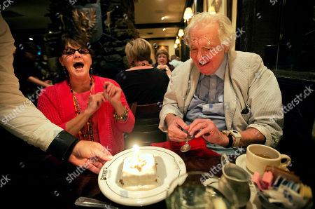 """John Jay Hooker, Holly Spann John Jay Hooker, right, celebrates his 85th birthday with friend Holly Spann at a restaurant in Nashville, Tenn. Hooker is a talker, and to accompany him on a given day is to be bombarded with one fantastical tale after another. Muhammad Ali gave him a shout-out on television after winning the heavyweight championship fight known as the """"Thrilla in Manila."""" Actor-director Warren Beatty is calling at lunch and Hooker even lived in Robert Kennedy's house for a time while working as his special counsel"""