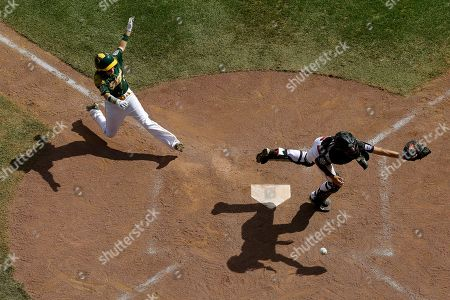 Stock Image of Treghan Parker, left, of Webb City, Mo., slides home to score as Canada catcher Kai Cuminskey chases a wild throw from the outfield on a hit by Brett Graham during the sixth inning of a consolation baseball game at the Little League World Series, in South Williamsport, Pa. Webb City, Mo. won 18-6