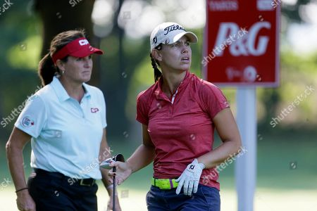 Karine Icher, Lorie Kane Karine Icher of France, right, watches her drive on the 17th hole as Lorie Kane walks up for her drive during the first round of the Meijer LPGA Classic golf tournament at Blythefield Country Club, in Belmont, Mich