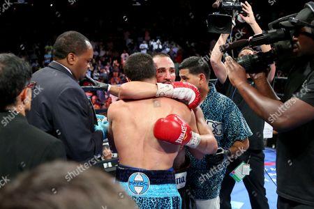 Danny Garcia, Paul Malignaggi Danny Garcia embraces Paul Malignaggi after their welterweight fight at the Barclays Center in Brooklyn, on . Garcia won via TKO in Round 9