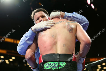 Arthur Mercante, Paul Malignaggi Referee Arthur Mercante hugs Paul Malignaggi and stops his fight against Danny Garcia in their welterweight fight at the Barclays Center in Brooklyn, on . Garcia won via TKO in Round 9